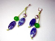 Green and blue earrings.  Lovely dainty dangle earrings from jewellery designer Jana Sobelmann of JanArt.  Each dangle earring consists of 2 green silk cords, one short and one long, each featuring 2 glass stones in blues, greens and silver.