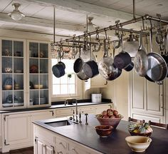 love the painted interior of the built in hutch, the ceiling, the soapstone and the pot rack