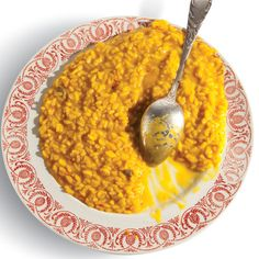 Risotto alla Milanese by Saveur. We may have the master glazier of Milan's cathedral to thank for risotto alla Milanese, the creamy rice dish that gets its vivid color and flavor from saffron. Side Dish Recipes, Rice Recipes, New Recipes, Cooking Recipes, Recipies, Favorite Recipes, Orzo Recipes, Potluck Recipes, Simple Recipes