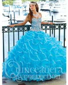 Quinceanera Dress #26752 Quinceanera ball gown, strapless sweetheart neckline, heavy sequin, crystal beading along bodice, elegant full organza cascading ruffle skirt with metallic edging, scattered crystal stones throughout skirt, lace up back. Organza
