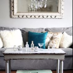 Love this for a small living room! Wouldn't it be cool to frame a window like it is a picture or mirror? I love the frame around this mirror.