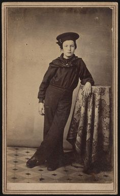 Sailor John F.W. Mitchell. His Naval Enlistment Rendezvous record indicates he enlisted in the US Navy in 1865 at the age of 14, assuming the rank of 3rd Class Apprentice. Mitchell was born in New York City, stood 4′8″ tall, had hazel eyes, and a mole on his right knee. He served on board the training ship U.S.S. Sabine. Source: Library of Congress.