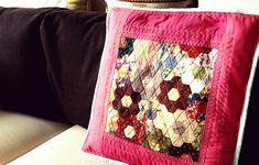 I don't know how did I persist to handstitch all of these pieces up ,many years ago. And today I decided to turn the grandma's garden patchwork pieces into a cushion cover. This brighten up my living room instantly.  Grandmother garden patchwork cushion