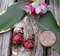 Set a reminder for this Auction!   Little Lady Bug Earrings, Lampwork by Nancy Gant. Starting at $15 on Tophatter.com!
