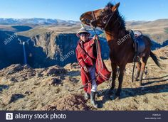 A Young Shepherd Guides His Horse Along The Cliffs Of Lesotho Near Stock Photo, Royalty Free Image: 86487490 - Alamy