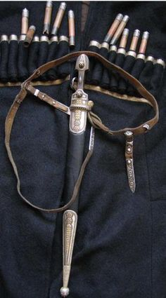 Russian Cossack Caucasian Kindjal and sword belt with silver decorations.