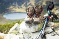Photo about Mountain boots and trekking sticks on mountain peak and lake on background. Image of people, lake, leather - 83876183 Mountain Equipment, T Mo, Pattern Drawing, Esports, Trekking, Hiking Boots, Pattern Design, Combat Boots, Box Templates