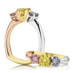 A stunning Calleija creation featuring Fancy Blue, Yellow & Pink Diamond in a Trilogy setting crafted from 18ct White, Yellow & Rose Gold