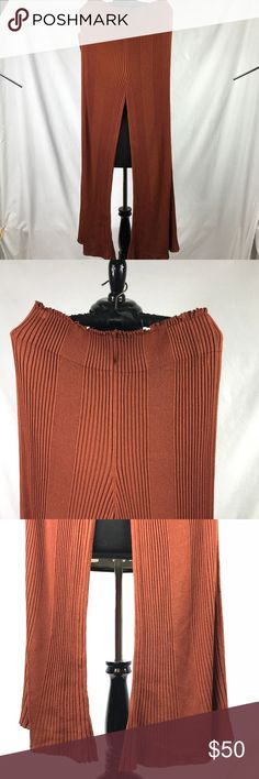 """Free People Wide Leg Pull On Pants Wide leg pull on pants but more likely palazzo style. Preowned but in great condition Color : Dark Pumpkin  Size : Large Material : Knit (very stretchy and soft) 48"""" long No pocket Please review photos for better judgement of the item's condition No return No exchange No trade Free People Pants Wide Leg"""