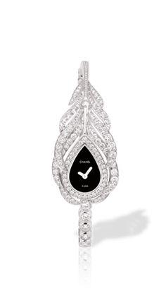 18K white gold and diamonds. High precision quartz movement. Price upon request.