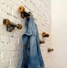 skate board wheels for hooks. Boys bedroom idea.