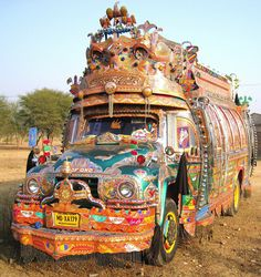 "Until you've seen one of these Pakistani buses barreling down a ""2-lane"" winding dirt road at you, you haven't lived!"