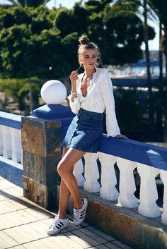For a retro, casual style, try pairing a denim button front skirt with Adidas superstars and a plunge neck white blouse! Via Josefin Ekström. Top: Aeryne Paris, Skirt: Bikbok.