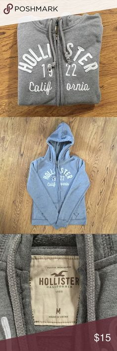 Hollister Hoodie Basic Brand Logo Grey Zip Jacket This is your typical Hollister hoodie, with the brand name featured on the front. It is light grey with white lettering. I have worn it enough to break it in, but it is still in great condition. Hollister Tops Sweatshirts & Hoodies