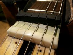 Realizzazione nuovo capotasto in osso per chitarra elettrica