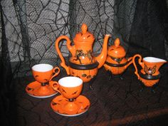 Buy an old garage sail tea set and paint it with orange enamel for an Alice In Wonderland theme.