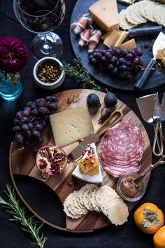Two boards, one wood and one black marble, with cheeses and meats #winecheese
