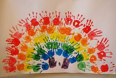 "Handprint Rainbow - I did a similar one with my preschoolers.  A lot of ""teacher work"" but totally cool finished product!"