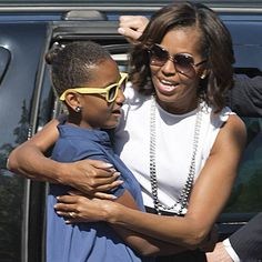 US first lady Michelle Obama hugs her daughter Sasha as they arrive to visit the Holocaust Memorial to the Murdered Jews of Europe in Berlin on June US President Barack Obama and first lady Michelle are on a two-day official visit to Germany.