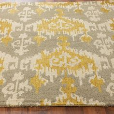 Hand Hooked Gray and Gold Ikat Rug.  @Michelle Story I found this site with discount rugs.  Not sure if you are getting one, but they are nice.