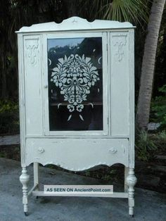 Vintage cabinet w/etched glass. Love that idea!