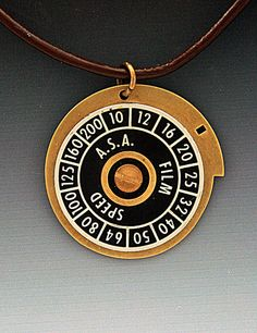 Pendant Necklace Circular OOAK of Old Camera by DeveauxDesigns
