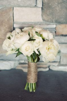 i like this for the bouquet. Should we add some baby's breath though? Or should we just do that for the bridesmaids-same flowers, but less and baby's breath?