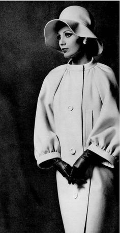1962 Model in ivory velvet-wool coat with raglan sleeves and banded collar and cuffs by Nina Ricci, photo by Georges Saad