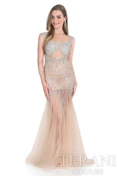 Crystal embellished illusion mermaid prom gown. This prom dress is finished with godets at the skirt and a nude lining.