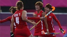 Seul Ki Cheon of Republic of Korea celebrates scoring the opening goal with her team mates during the women's Hockey preliminary match between Republic of Korea and Japan on Day 6 of the London 2012 Olympic Games at Riverbank Arena