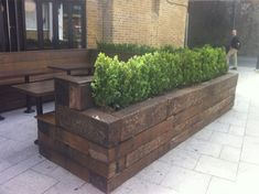 A restaurant i passed in Hoxton London had made great use out of old railway sleepers, using them to make planters, tables and seating, now thats great recycling. Courtyard Design, Backyard Garden Design, Patio Design, Outdoor Landscaping, Outdoor Gardens, Outdoor Decor, Railway Sleepers Garden, Sunken Patio, Garden Retaining Wall