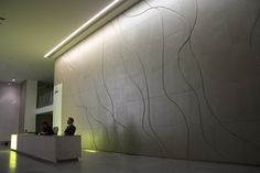 Harcourt London - Leather wall designed to replicate the veins found in marble.