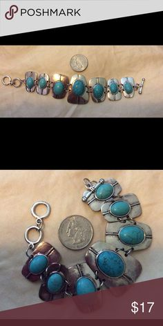 Bracelet Faux turquoise and silver bracelet with toggle latch. Very pretty bracelet.  New without tags Jewelry Bracelets