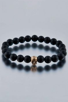 Matte Onyx with Gold Skull Bead Bracelet....just needs to be in silver