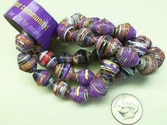 Beads made from Girl Scout Samoas' boxes. Cute! Remeber for next year after cookie sales for maybe a recycling craft
