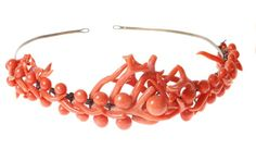 Small Coral Bandeau c1840. A mid 19th century tiara the centre set with two graduated lines of 8mm to 12mm coral beads with branch coral edges, on a gilt metal frame. (Dreweatts)