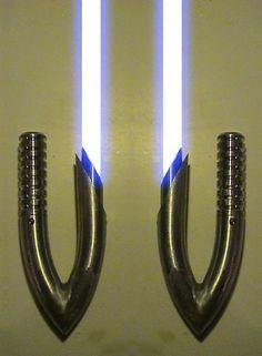 Google Image Result for http://fc02.deviantart.net/fs71/f/2010/042/9/f/Lightsaber_Hook_Hilts_by_hapajedi.jpg