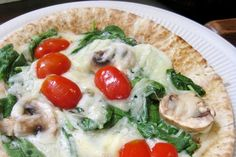 Quick and easy! Just warm in microwave! Tortilla, spinach, tomatoes,  and mozzarella.