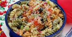 Tri-color rotini pasta is paired with red onion, celery, green and red bell pepper, black olives, chopped tomato and dressed with an Itali...