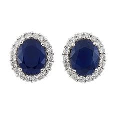 Pair of White Gold, Sapphire and Diamond Earrings 18 kt., 2 oval sapphires approx..6.35 cts., round diamonds approx. 1.10 cts.