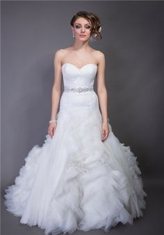 Italian Silk Satin/organza.  Dropped waist A-line gown.  Strapless sweetheart neckline bodice with princess seams.  Skirt is accented with curved organza strips and ruffle detail.   Buttons accent back of bodice.
