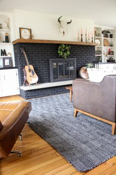 Contemporary Fireplace Design Ideas for All Cozy Feels - Black brick fireplace painted for contemporary room design ideas - Black Brick Fireplace, Painted Brick Fireplaces, Fireplace Doors, Paint Fireplace, Brick Fireplace Makeover, Fireplace Hearth, Home Fireplace, Fireplace Remodel, Paint Brick
