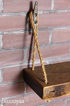 Rustic Reclaimed Rope Shelf With Boat Cleat Hangers by Blissopia