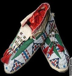 These buckskin moccasins above, notable for their geometric beadwork and red tassels, date from the 20th century. They were made by Julia Lucinda, a member of the Rosebud Sioux tribe. Crafted from hide, glass beads, cotton fabric and sinew, the moccasins are a superb example of Sioux decorative techniques. The Rosebud Sioux are a branch of the Lakota people of South Dakota.