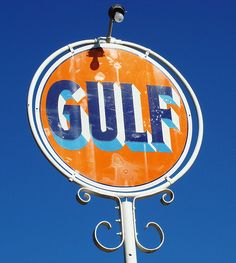 Old Gulf Oil Company sign in Marshall, North Carolina, May 2007 by alcomike43, via Flickr