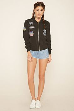 """A woven long-sleeved bomber jacket featuring contrast ribbed knit trim, an exposed front zipper closure, slanted front pockets, and various embroidered patches such as """"Route 66"""", """"I Believe In Love"""", """"State Champions 1987"""", and more."""