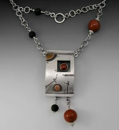 """early imbrian front  1 1/4"""" x 2""""    Fabricated Sterling silver centerpiece with handcrafted chain and clasp. Black oxidized detailing and copper accents. 24"""" chain with red agate and lava beads.  by Alex Metal Arts, via Flickr"""