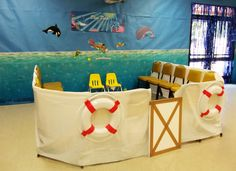 VBS Operation Overboard at Village UMC. Use sheets to create a boat. The life preservers were ordered from Oriental Trading and come 4 to a pack and are lightweight. Make a door for the boat out of foam insulation board. A ful place for children to sit and hear a Bible story.