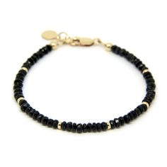 This glamorous bracelet features 4-5mm faceted Black Spinal gemstones and 14 carat gold filled beads set in 14 carat gold filled with a lobster clasp to fasten and finished with a 10mm engravable disk charm attached to personalise. Size is medium, approx 18.5cm and extendable.