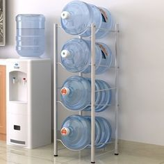 【Space Saver】The standing water bottle rack has a very small footprint. It can help you saving floor space to keep it neat and clean, no more mess!Keep your house clean and tidy, while still keeping your mood happy. 5 Gallon Water Bottle, Water Bottle Storage, Water Jugs, Water Bottles, Home Office Furniture Sets, Unique Furniture, Metal Rack, Bottle Rack, Kitchen Organization
